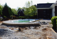 Pour standard concrete decking around fiberglass pool